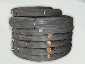 Seven layers of spiral ribbed PC wire are tied up with steel baling strips. And each layer is separated with a wooden block.