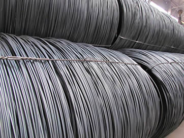 Two layers of plain PC wire in coils are tied up with iron baling strips.